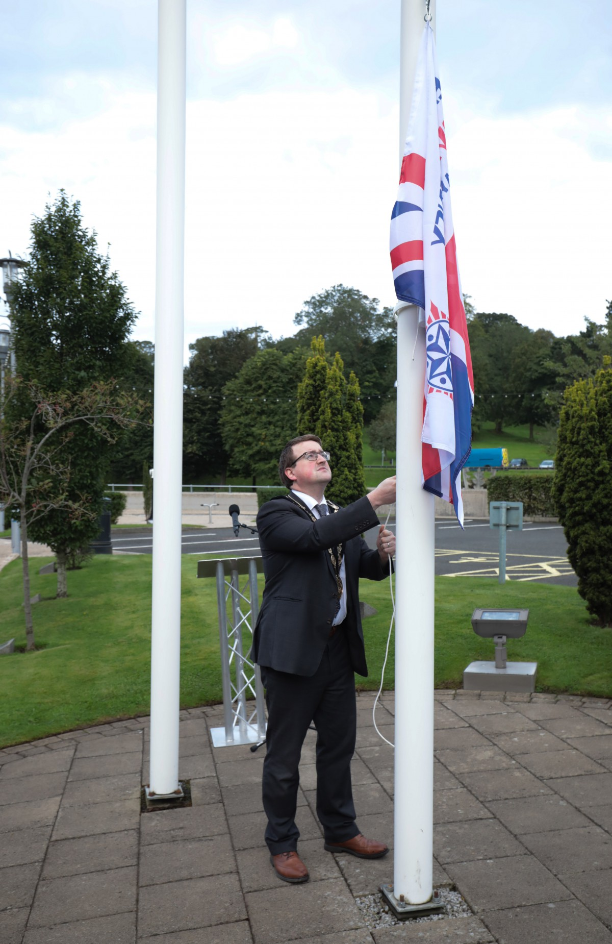 The Mayor, Councillor Nicholas Trimble raising the 999 Emergency Services Flag